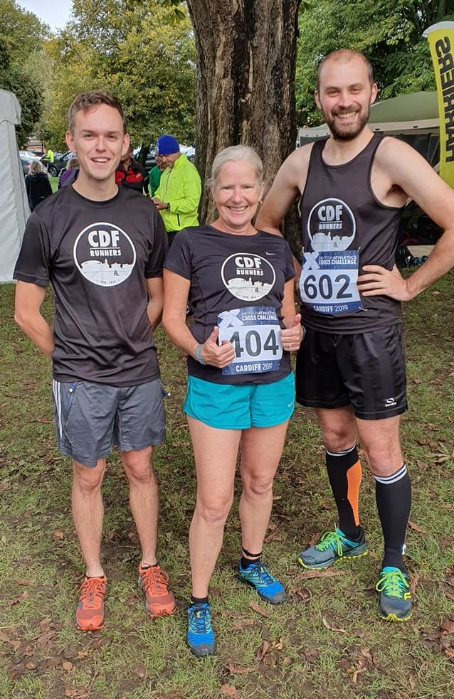 Sam, Debbie and Stewart standing in their running gear and trail shoes
